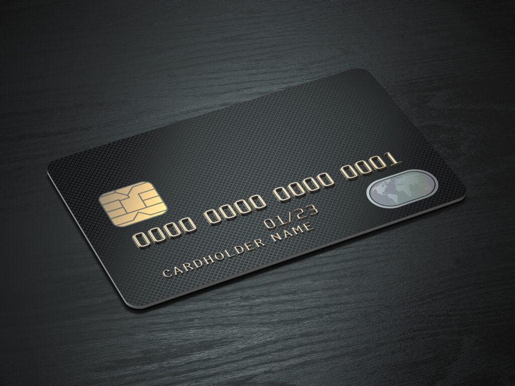 black card on black wood table