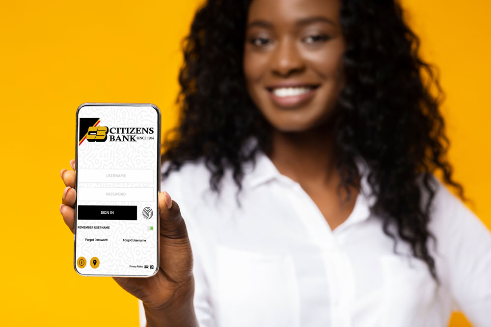 young woman holding out phone with new digital banking login screen