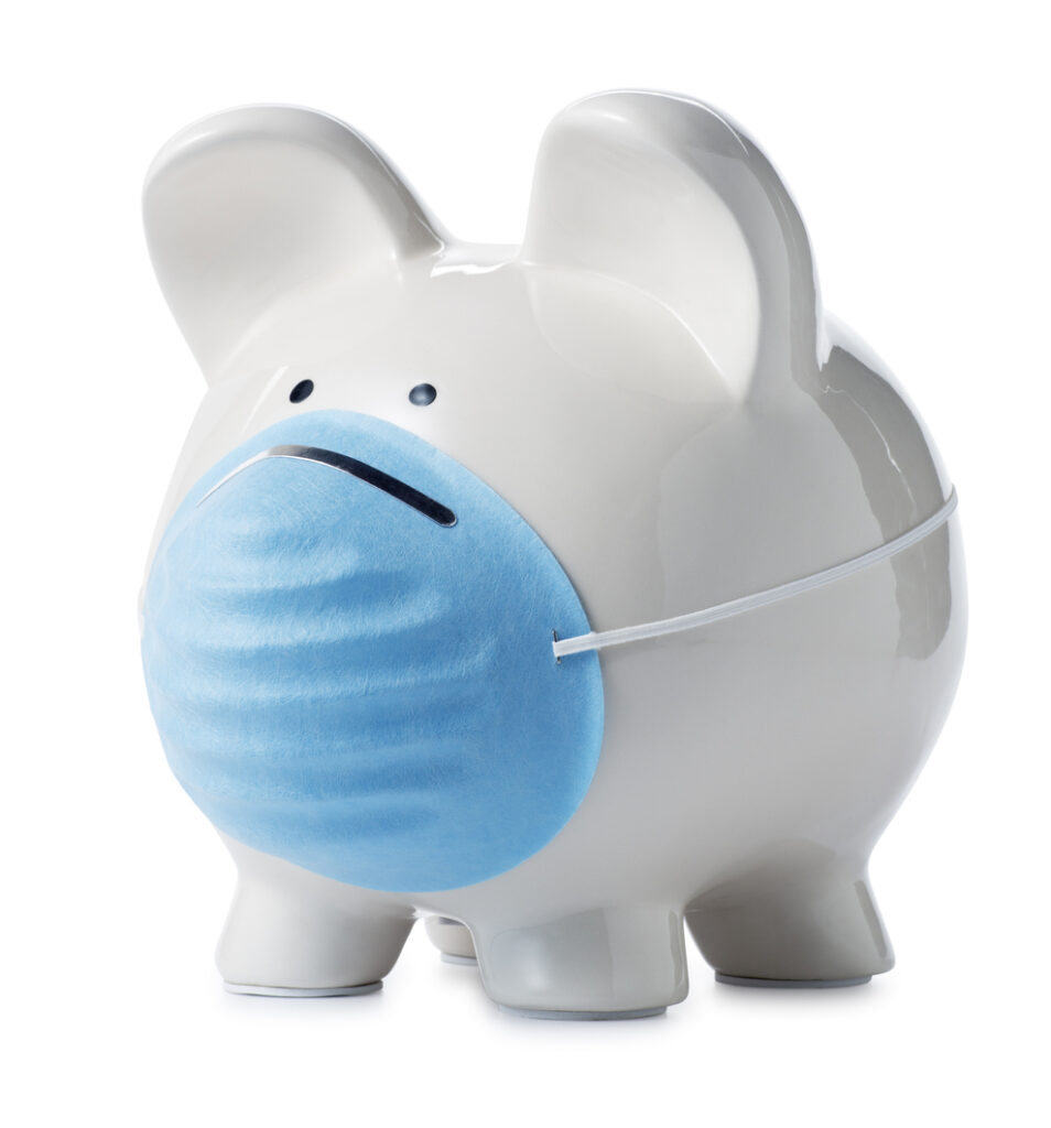 white piggy bank with medical mask on