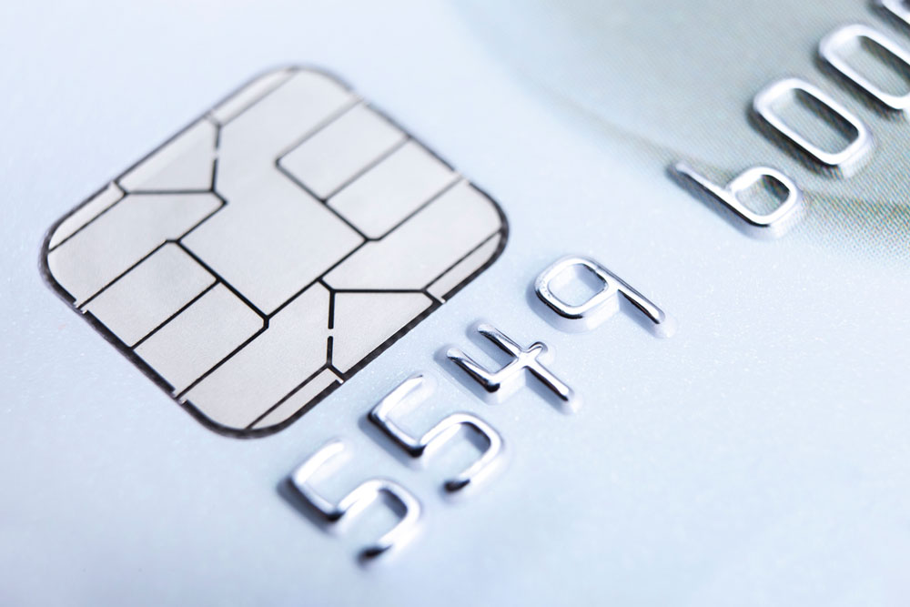 upclose view of a white credit card with chip